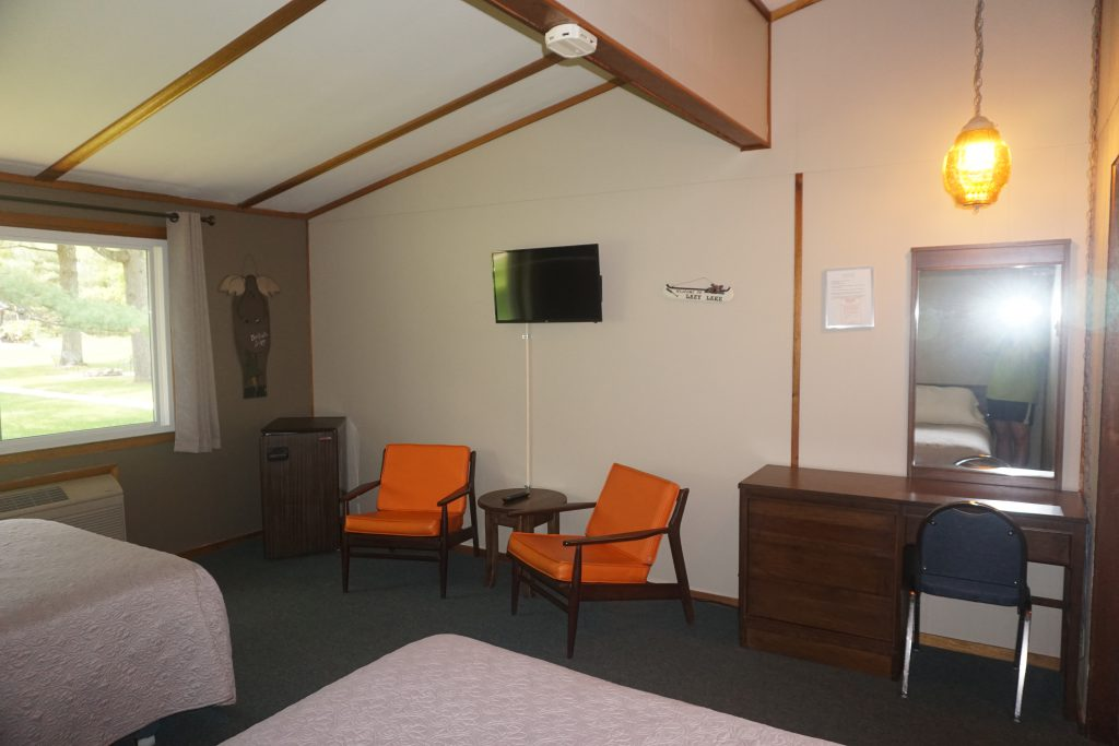 Motel Room Seating Area with Refrigerator and TV